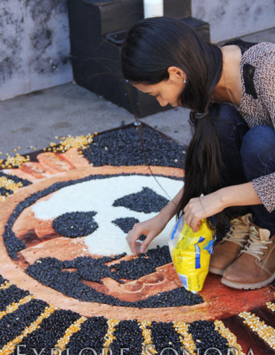 Creating a tapete de arena with corn, rice, beans and other items