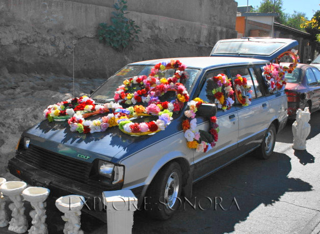Selling flowers outside the cemetery on the Day of the Dead in Sonora
