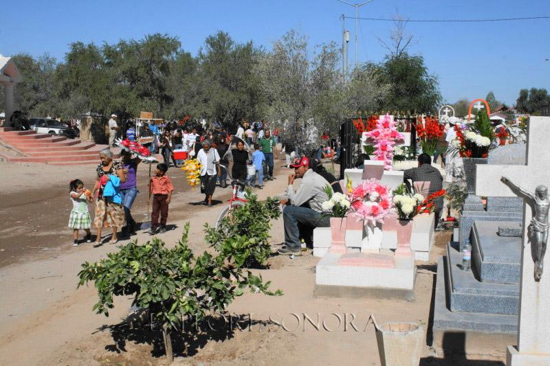 Scene in a Sonora, Mexico cemetery during Dia de los Muertos